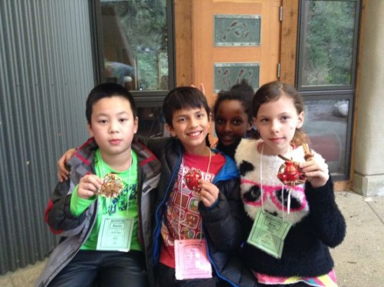 Students at IslandWood with their Clam Shell Rattle Necklaces