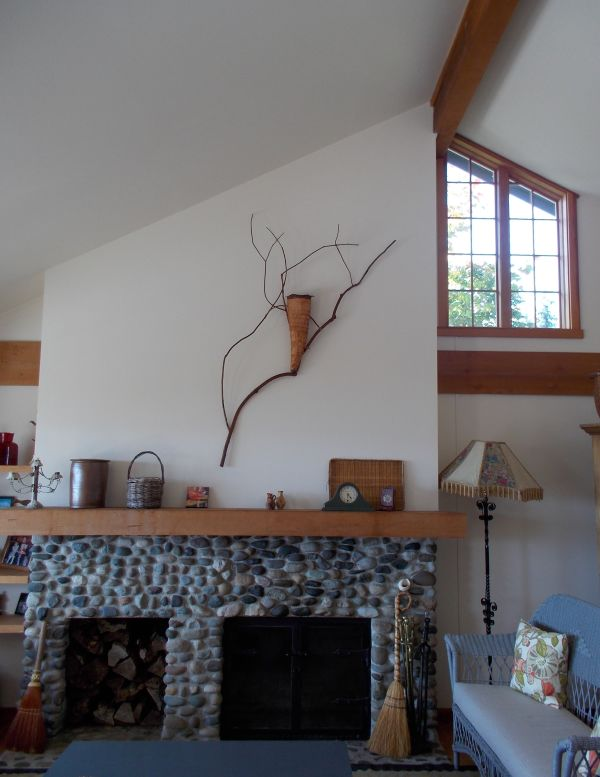 Wall sculpture and fireplace
