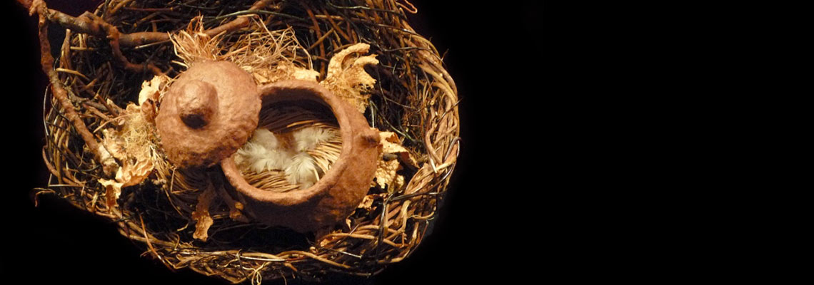 Nest sculpture by Melinda West made from willow, ivy, apple branches, cedar paper, assorted grasses