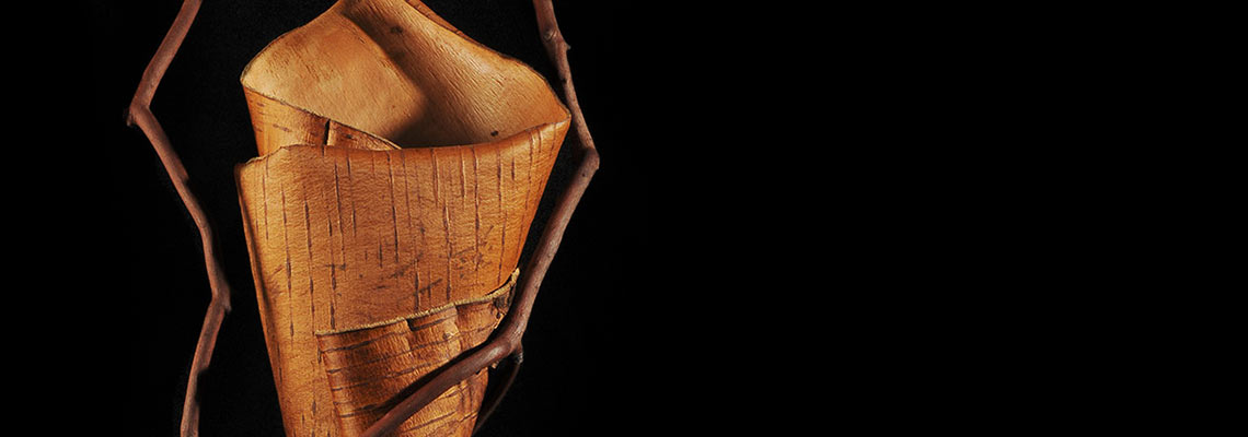 Detail of sculpture made from shaped wild cherry bark sewn to Madrona branch