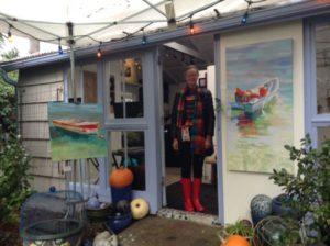 Painter, Sydni Sterling, in the doorway of her garden studio.