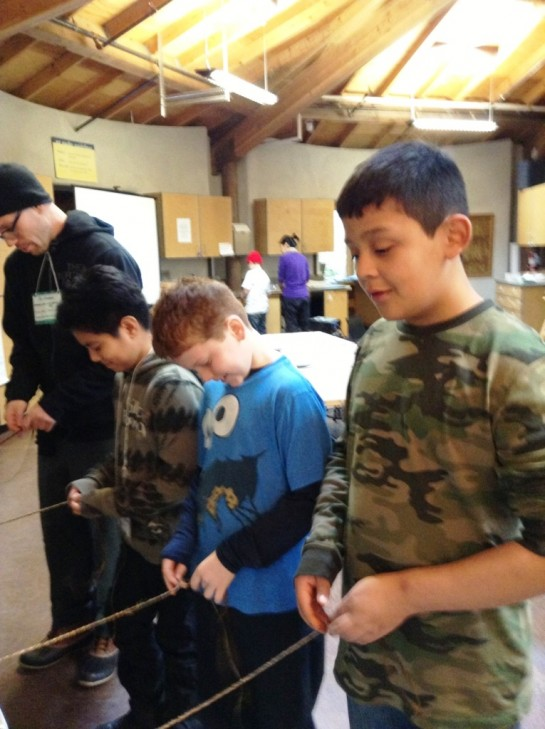 5th graders at IslandWood make cordage, 2013