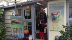 Painter, Sydni Sterling, in the doorway of her garden studio.